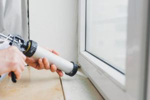 Caulking window inside home